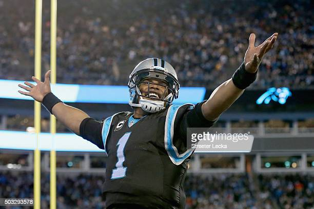 Cam Newton of the Carolina Panthers reacts after a 4th quarter touchdown against the Tampa Bay Buccaneers during their game at Bank of America...
