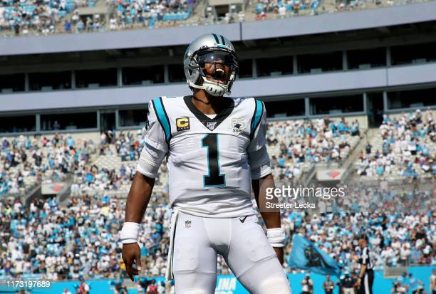Cam Newton of the Carolina Panthers reacts after a Panthers touchdown during their game against the Los Angeles Rams at Bank of America Stadium on...
