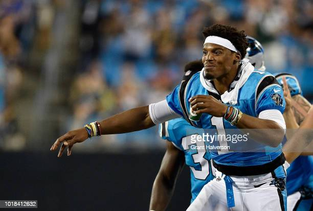 Cam Newton of the Carolina Panthers reacts after a third quarter touchdown against the Miami Dolphins during the game at Bank of America Stadium on...