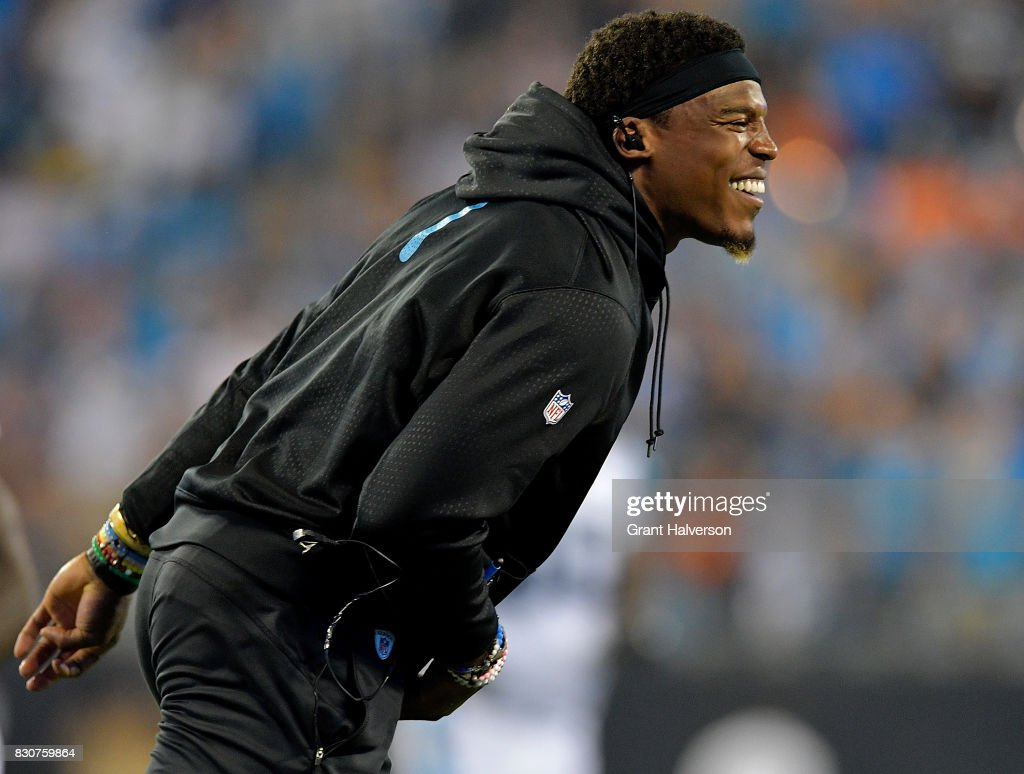 Cam Newton #1 of the Carolina Panthers reacts after a touchdown against the Houston Texans during their game at Bank of America Stadium on August 9, 2017 in Charlotte, North Carolina.