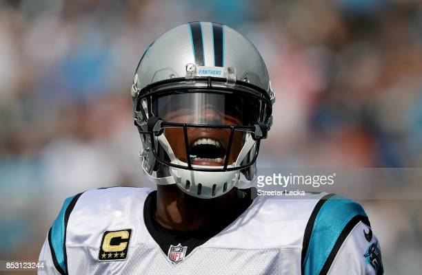 Cam Newton of the Carolina Panthers reacts after a touchdown against the New Orleans Saints during their game at Bank of America Stadium on September...