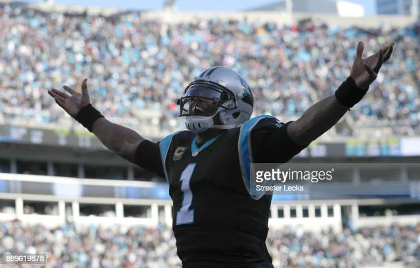 Cam Newton of the Carolina Panthers reacts after a touchdown against the Minnesota Vikings in the third quarter during their game at Bank of America...