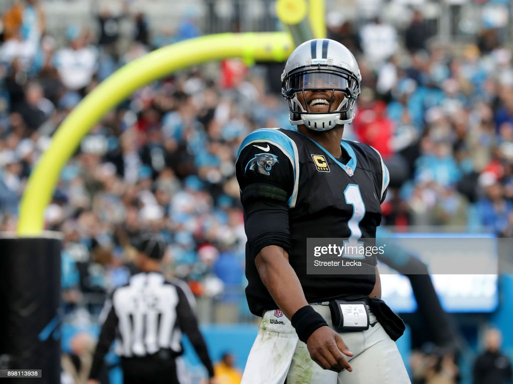 Cam Newton #1 of the Carolina Panthers reacts after scoring the game winning touchdown against the Tampa Bay Buccaneers in the fourth quarter during their game at Bank of America Stadium on December 24, 2017 in Charlotte, North Carolina.