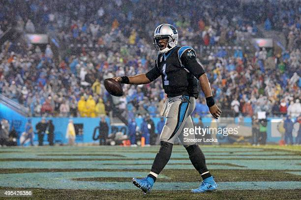 Cam Newton of the Carolina Panthers reacts after the Panthers score a touchdown against the Indianapolis Colts during their game at Bank of America...