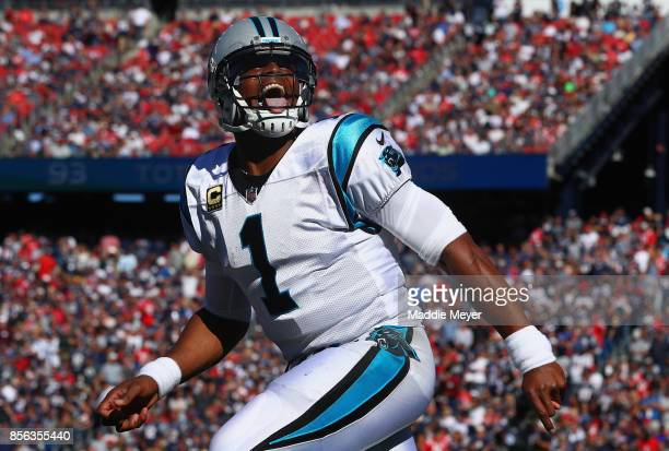 Cam Newton of the Carolina Panthers reacts after throwing a touchdown pass to Devin Funchess during the third quarter against the New England...