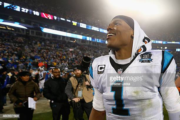 Cam Newton of the Carolina Panthers reacts after winning 27-16 against the Arizona Cardinals after their NFC Wild Card Playoff game at Bank of...