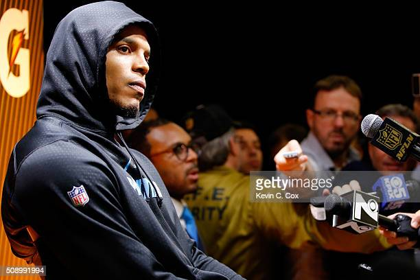Cam Newton of the Carolina Panthers reacts during his postgame press conference after the Denver Broncos defeated the Carolina Panthers with a score...