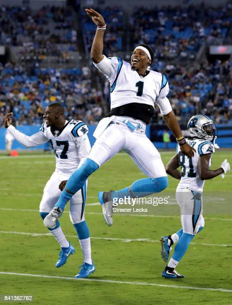 Cam Newton of the Carolina Panthers reacts on the sidelines against the Pittsburgh Steelers during their game at Bank of America Stadium on August 31...