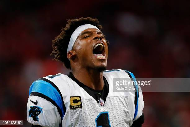 Cam Newton of the Carolina Panthers reacts to a late hit during the first half against the Atlanta Falcons at MercedesBenz Stadium on September 16...