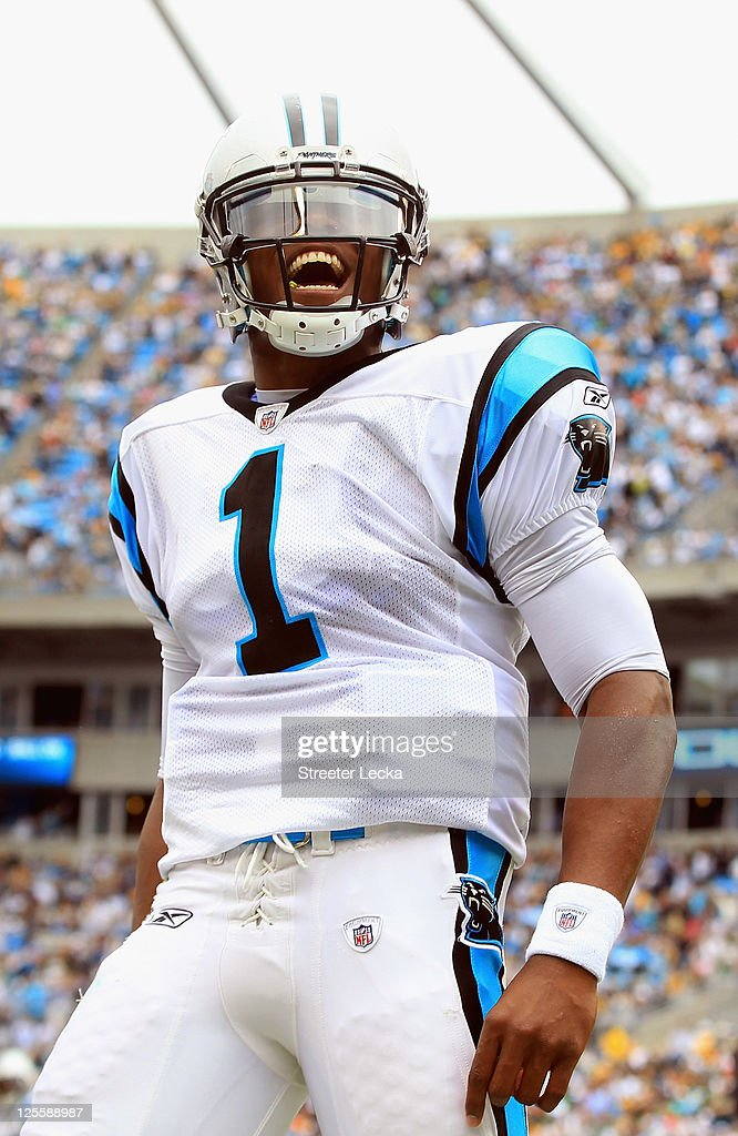 Cam Newton #1 of the Carolina Panthers reacts to a touchdown against the Green Bay Packers during their game at Bank of America Stadium on September 18, 2011 in Charlotte, North Carolina.