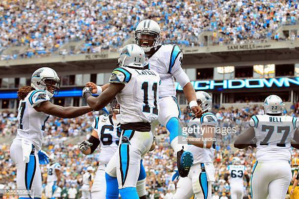 Cam Newton of the Carolina Panthers reacts to a touchdown against the Green Bay Packers during their game at Bank of America Stadium on September 18,...