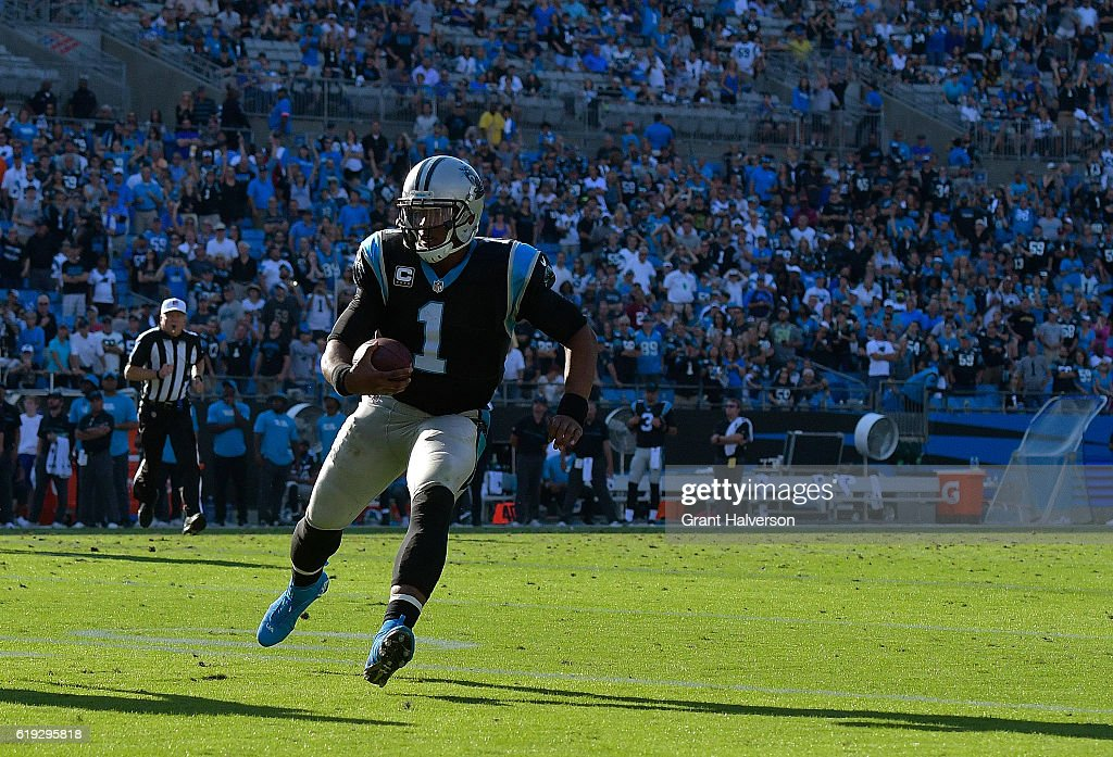 Cam Newton #1 of the Carolina Panthers runs against the Arizona Cardinals during the game at Bank of America Stadium on October 30, 2016 in Charlotte, North Carolina.