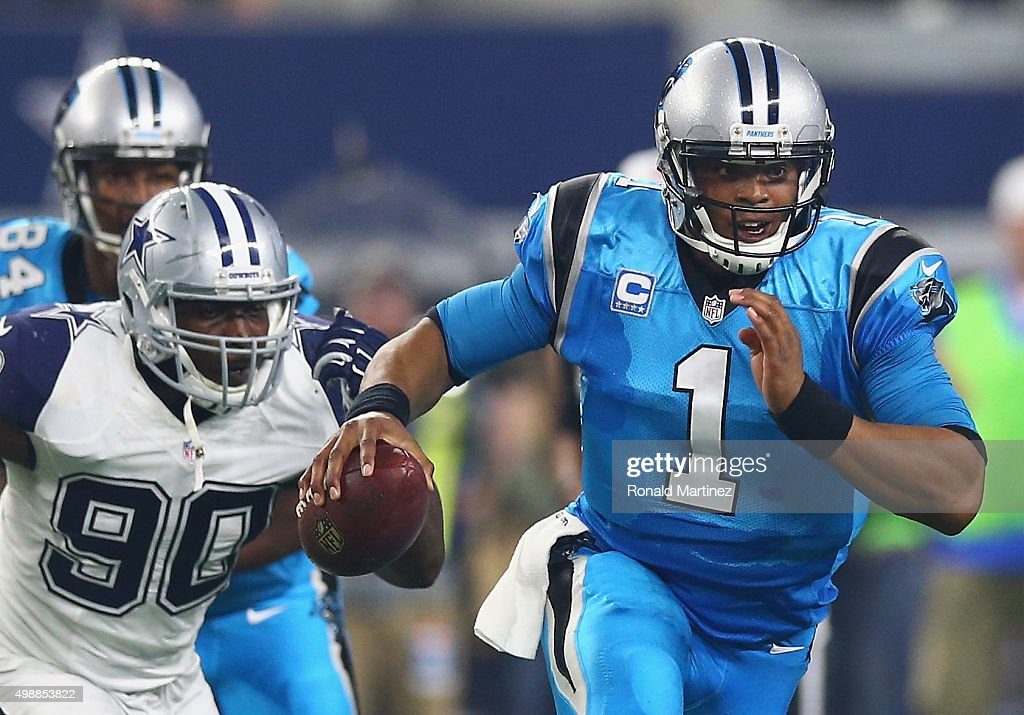 Cam Newton #1 of the Carolina Panthers runs against the Dallas Cowboys in the second quarter on November 26, 2015 in Arlington, Texas.
