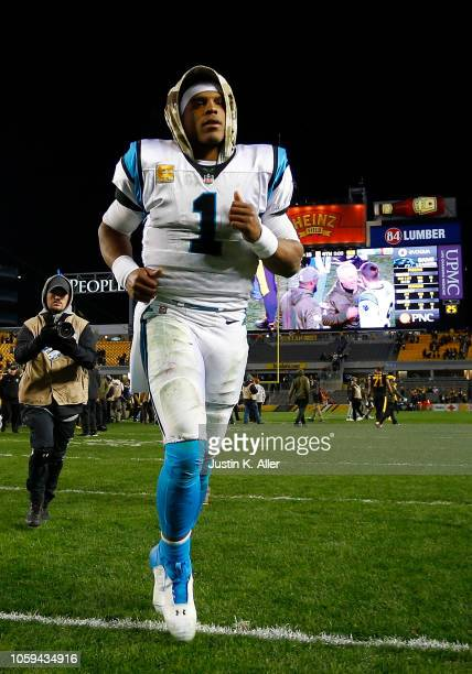 Cam Newton of the Carolina Panthers runs off the field after being defeated by the Pittsburgh Steelers 5221 at Heinz Field on November 8 2018 in...