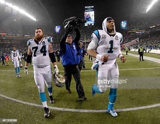 Cam Newton of the Carolina Panthers runs off the field after being defeated by the Seattle Seahawks in the 2015 NFC Divisional Playoff game at...