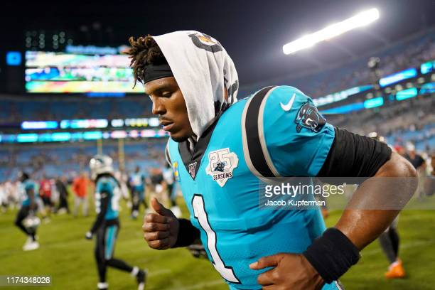 Cam Newton of the Carolina Panthers runs off the field after their game against the Tampa Bay Buccaneers at Bank of America Stadium on September 12...