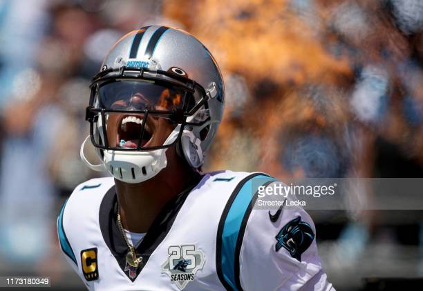 Cam Newton of the Carolina Panthers runs onto the field during player introductions before their game against the Los Angeles Rams at Bank of America...