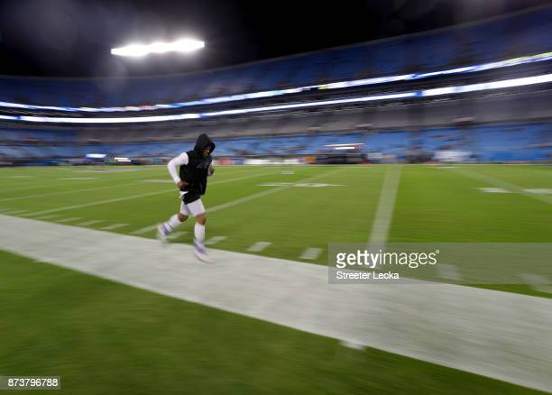 Cam Newton of the Carolina Panthers runs onto the field to warm up before their game against the Miami Dolphins at Bank of America Stadium on...