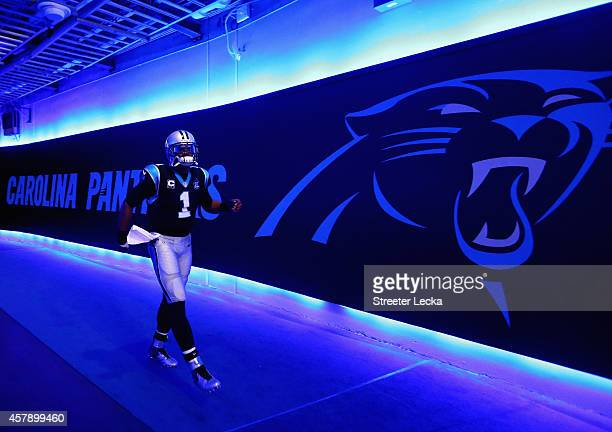 Cam Newton of the Carolina Panthers runs out to be introduced before their game against the Seattle Seahawks at Bank of America Stadium on October 26...