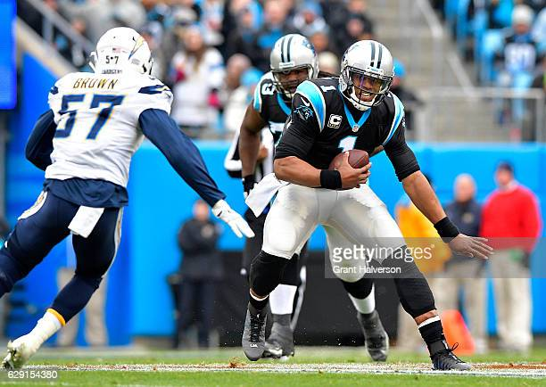 Cam Newton of the Carolina Panthers runs the ball against Jatavis Brown of the San Diego Chargers in the 1st quarter during the game at Bank of...