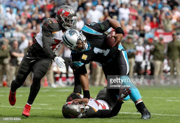 Cam Newton of the Carolina Panthers runs the ball against Justin Evans of the Tampa Bay Buccaneers in the first quarter during their game at Bank of...
