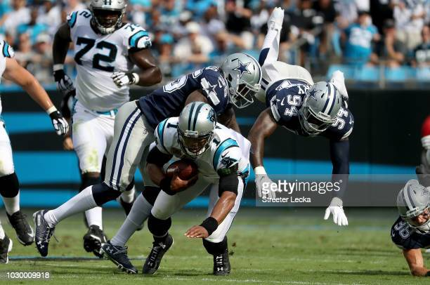 Cam Newton of the Carolina Panthers runs the ball against Randy Gregory of the Dallas Cowboys in the first quarter during their game at Bank of...