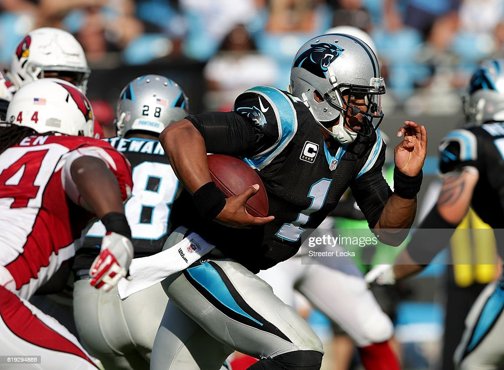 Cam Newton #1 of the Carolina Panthers runs the ball against the Arizona Cardinals in the 4th quarter during their game at Bank of America Stadium on October 30, 2016 in Charlotte, North Carolina.