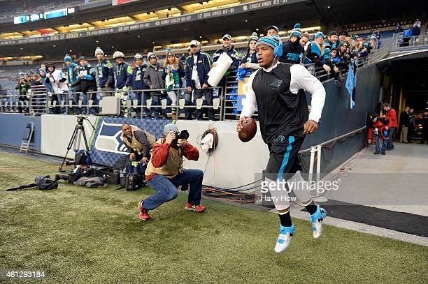Cam Newton of the Carolina Panthers runs to the field prior to their 2015 NFC Divisional Playoff game against the Seattle Seahawks at CenturyLink...