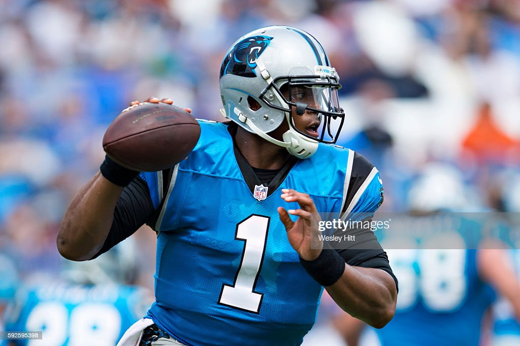 Cam Newton #1 of the Carolina Panthers runs with the ball and fakes a pass during a preseason game against the Tennessee Titans at Nissan Stadium on August 20, 2016 in Nashville, Tennessee.