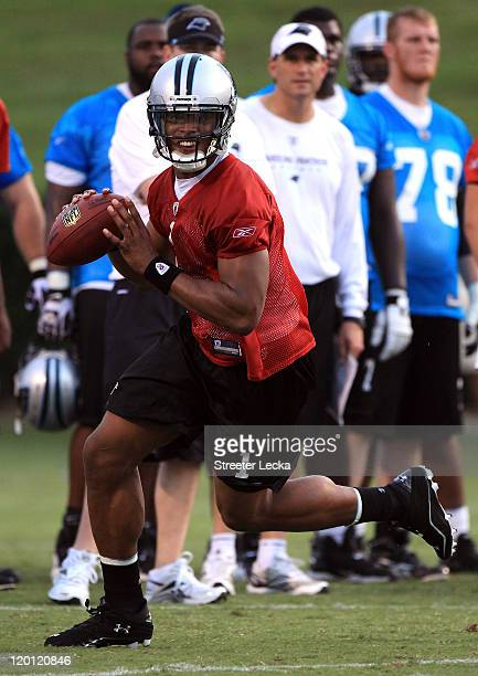 Cam Newton of the Carolina Panthers runs with the ball during training camp at Wofford College on July 30, 2011 in Spartanburg, South Carolina.
