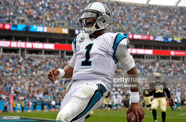 Cam Newton of the Carolina Panthers rushes for a fourth quarter touchdown against the New Orleans Saints during their game at Bank of America Stadium...