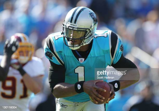 Cam Newton of the Carolina Panthers rushes for a second half touchdown during their game against the Washington Redskins at Bank of America Stadium...