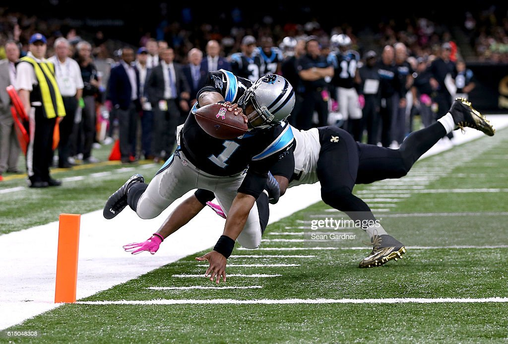 Cam Newton #1 of the Carolina Panthers scores a touchdown against Cameron Jordan #94 of the New Orleans Saints during the fourth quarter at the Mercedes-Benz Superdome on October 16, 2016 in New Orleans, Louisiana.