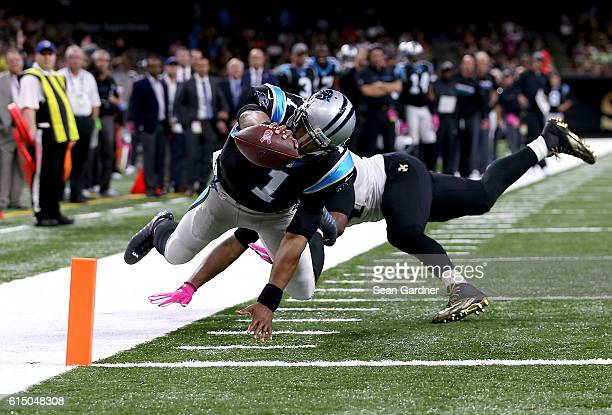 Cam Newton of the Carolina Panthers scores a touchdown against Cameron Jordan of the New Orleans Saints during the fourth quarter at the MercedesBenz...