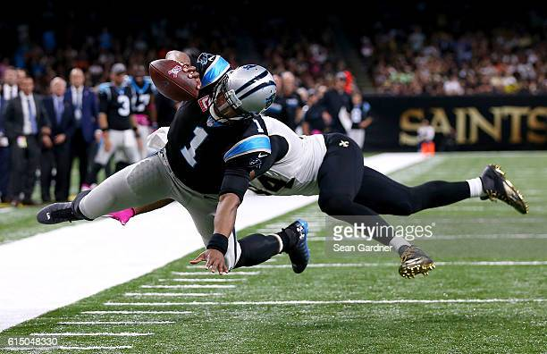 Cam Newton of the Carolina Panthers scores a touchdown against Cameron Jordan of the New Orleans Saints during the fourth quarter at the...