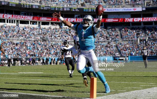 Cam Newton of the Carolina Panthers scores a touchdown against the Baltimore Ravens in the fourth quarter during their game at Bank of America...