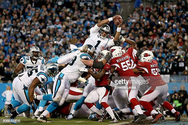 Cam Newton of the Carolina Panthers scores a touchdown in the second quarter against the Arizona Cardinals during the NFC Championship Game at Bank...