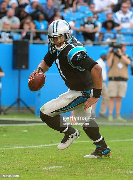 Cam Newton of the Carolina Panthers scrambles against the Atlanta Falcons at Bank Of America Stadium on December 13, 2015 in Charlotte, North...