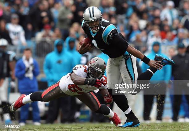 Cam Newton of the Carolina Panthers scrambles away from Lavonte David of the Tampa Bay Buccaneers during their game at Bank of America Stadium on...