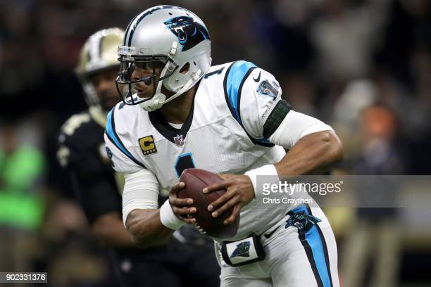 Cam Newton of the Carolina Panthers scrambles with the football against the New Orleans Saints at the MercedesBenz Superdome on January 7 2018 in New...
