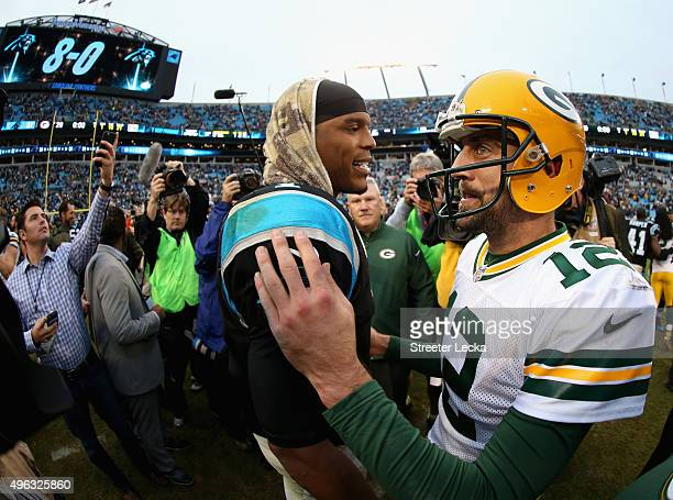 Cam Newton of the Carolina Panthers shakes hands with Aaron Rodgers of the Green Bay Packers after the Panthes defeated the Packers 3729 at Bank of...