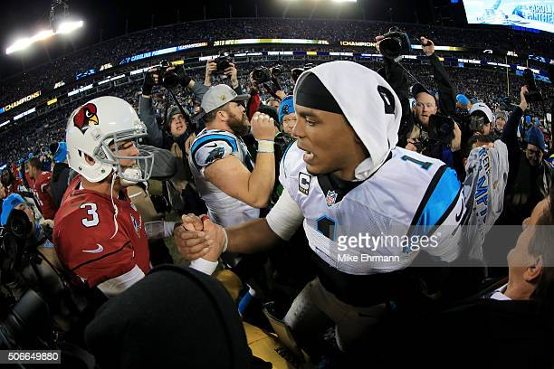 Cam Newton of the Carolina Panthers shakes hands with Carson Palmer of the Arizona Cardinals after the NFC Championship Game at Bank of America...
