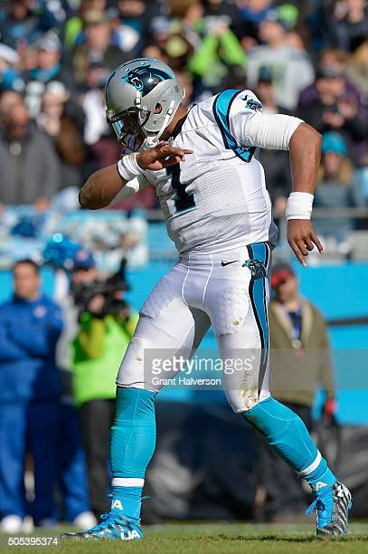 Cam Newton of the Carolina Panthers shows his trademark 'dab' against the Seattle Seahawks in the 2nd quarter during the NFC Divisional Playoff Game...