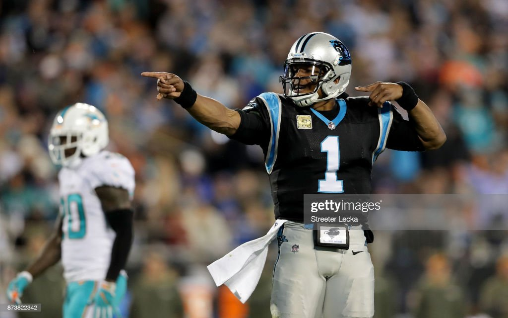 Cam Newton #1 of the Carolina Panthers signals a first down against the Miami Dolphins in the first quarter during their game at Bank of America Stadium on November 13, 2017 in Charlotte, North Carolina.
