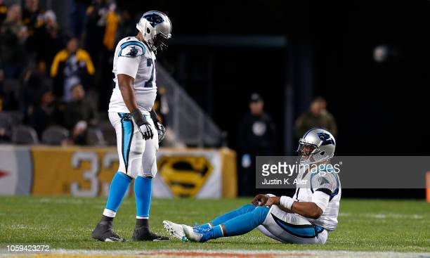 Cam Newton of the Carolina Panthers sits on the field after being sacked during the first half in the game against the Pittsburgh Steelers at Heinz...