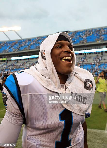 Cam Newton of the Carolina Panthers smiles as he walks off the field after defeating the Jacksonville Jaguars 1610 at Bank of America Stadium on...
