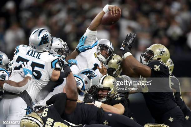 Cam Newton of the Carolina Panthers stretches for a first down against the New Orleans Saints at the MercedesBenz Superdome on January 7 2018 in New...