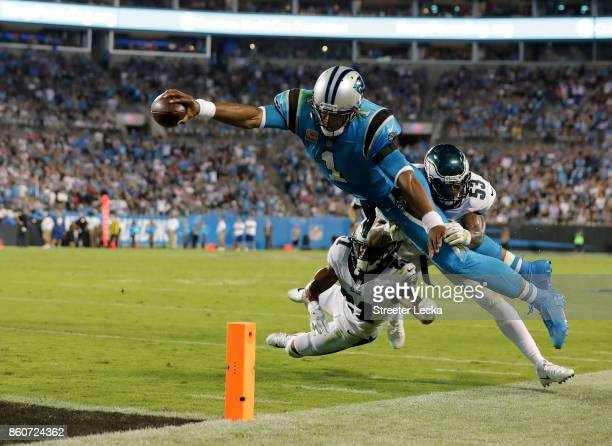 Cam Newton of the Carolina Panthers stretches for the goal line against the Philadelphia Eagles in the fourth quarter during their game at Bank of...