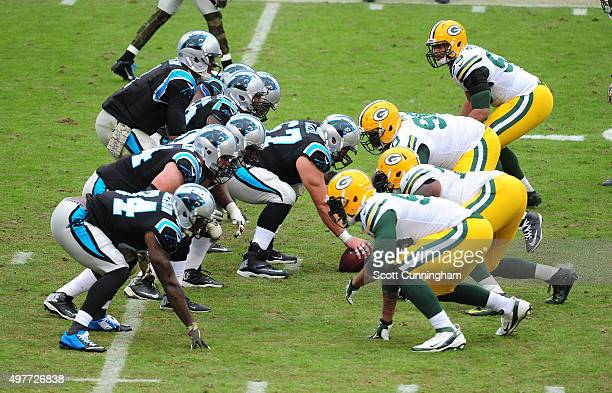 Cam Newton of the Carolina Panthers takes a snap against the Green Bay Packers at Bank Of America Stadium on November 8 2015 in Charlotte North...
