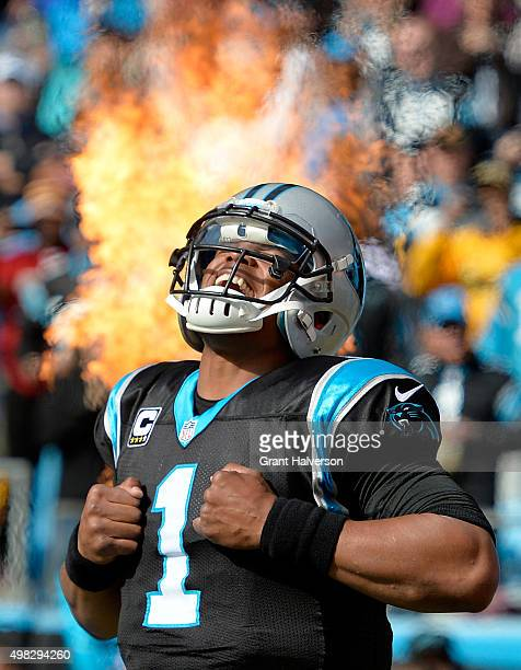 Cam Newton of the Carolina Panthers takes the field against the Washington Redskins at Bank of America Stadium on November 22 2015 in Charlotte North...